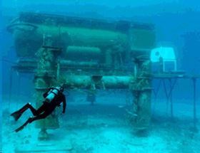 A diver approaches the Aquarius undersea research laboratory.