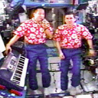 Astronaut Ed Lu celebrates (left) celebrates his 40th birthday aboard the International Space Station on July 1, 2003.