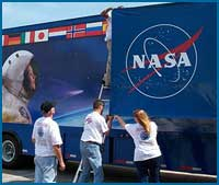 photograph of people opening door to the ISS exhibit trailer