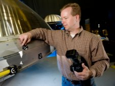 Rob Black, senior applications engineer with Shape Fidelity Inc.,  of Huntsville, Ala., a contractor with the Ares I Upper Stage team, sets  up for photogrammetry process