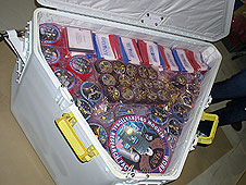 A host of flags and patches packed for flight.