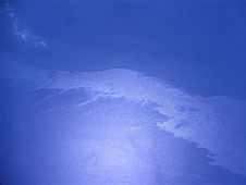 The Gulf oil slick is visible as a bright diagonal swath in this image taken at 28,000 feet from a camera mounted on Langley's B-200 research airplane.