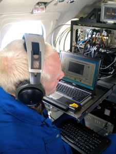Langley scientist Ray Rogers operates the sensing instruments on the B-200 research airplane as it takes data over the Gulf oil slick. Credit: NASA
