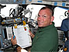 STS-132 Pilot Antonelli smiles from the shuttle flight deck