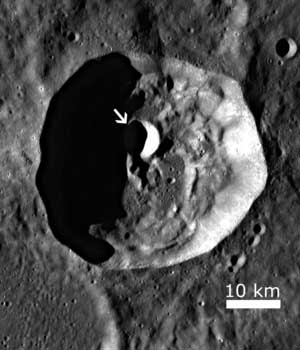 A house sized boulder rolled downhill, scoring a hole in one in this moon crater.