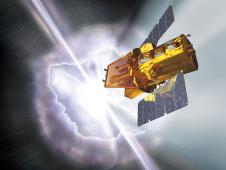 Artist's concept of swift spacecraft in flight with gamma-ray burst in background.