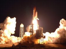 Space Shuttle Endeavour launches into an early morning sky at NASA's Kennedy Space Center.