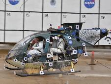 NASA dropped a small helicopter from 35 feet (10.7 m) to see if an expandable honeycomb energy absorber could lessen the destructive force of a crash