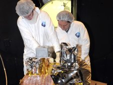 NASA scientists work on the Fast, Affordable, Science and Technology Satellite, or FASTSAT, after successfully completing a comprehensive preshipment review.