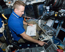 STS-132 Commander Ken Ham working with the avionics system.