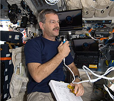 STS-125 Commander Scott Altman with laptop computers.