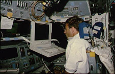 Astronaut works on laptop with PILOT program.
