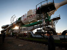 The Soyuz TMA-19 spacecraft is rolled out by train to the launch pad