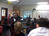 Students in a classroom raising their hands