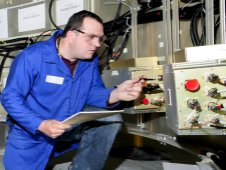 Engineers make final systems checks during avionics string tests.