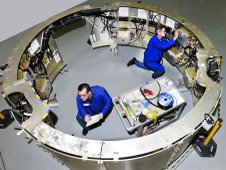 Engineers make final preparations for testing inside the avionics mounting structure.