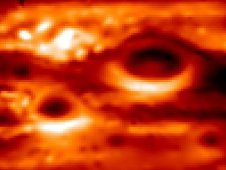NASA image of a thermal image of Jupiter Red Spot interacting with smaller storms on the planet
