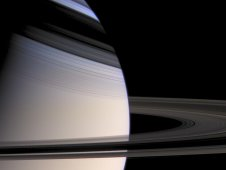 Cassini image of softly hued Saturn embraced by the shadows of its stately rings