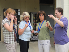 Teachers at the workshop conduct experiment measuring UV protection of sunglasses.