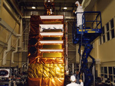 The Rossi X-ray Timing Explorer spacecraft undergoes pre-launch tests in 1995. Credit: NASA/GSFC