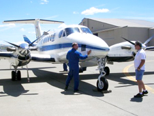 Pilot and crew chief inspect NASA's King Air B-200