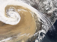 A satellite image of a typhoon-fueled dust storm in China