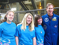 Three students and an astronaut