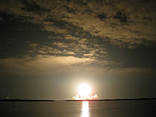 The space shuttle launching in the dark