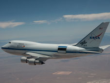The lower flexible door over the telescope cavity in the rear fuselage of NASA's Stratospheric Observatory for Infrared Astronomy is visible while the upper rigid door is opened during a test flight over the California high desert.