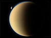 Saturn's moon Tethys slips behind Saturn's largest moon Titan