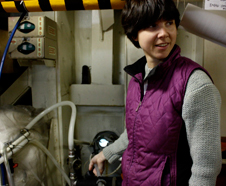 Emily Peacock of Woods Hole Oceanographic Institution removes the hose that pulls water from the Chukchi Sea. The water flows into an instrument that photographs and categorizes phytoplankton.