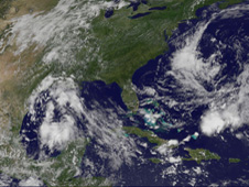 This GOES-13 image shows the system as an almost oval shaped area of clouds in the western Gulf of Mexico