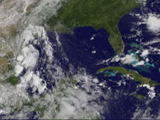 The visible image shows Tropical Depression 2 with several areas of clouds near the south Texas coast.