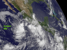 This visible image shows System 96E's circular area of clouds and showers off the southwestern coast of Mexico.