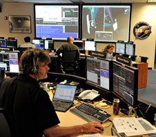 LRO Project Manager Craig Tooley examines data on LRO's orbit insertion around the moon