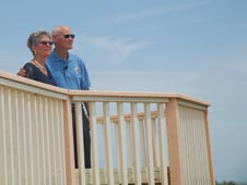 Former shuttle astronaut Mike Mullane and his wife, Donna, revisit the beach house in 2010.