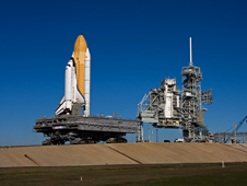 A crawler-transporter keeps space shuttle Endeavour level as it travels up the base of Launch Pad 39A