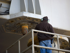 An aerospace technician prepares to secure space shuttle Endeavour to the pad