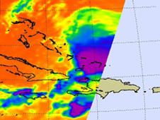 The purple area of TD 3 located over the southern Bahamas shows strong convection, and indicates heavy rainfall
