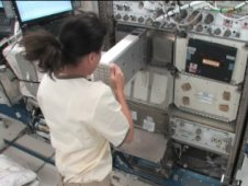 Astronaut Shannon Walker activates nanoracks.