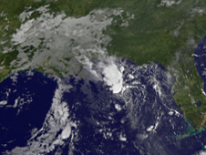 This image from the GOES-13 clearly shows Bonnie's center (the small circular area southeast of Louisiana).