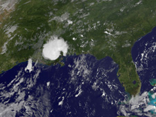 The GOES-13 satellite captured the remnants of Bonnie situated over Louisiana and western Mississippi on July 25.
