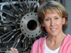 Sandy Elam in front of an engine test stand