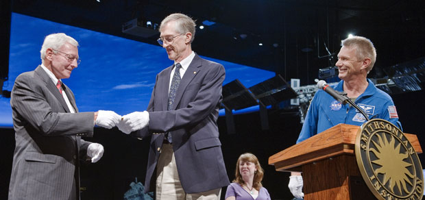 NASA Nobel laureate John Mather presents a replica of the prize flown in space during the STS-132 shutle mission to the Smithsonian's National Air and Space Museum. Credit: NASA/Paul Alers