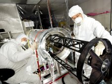 Technicians put the finishing touches on SUMI prior to buttoning up the outer skin of the telescope.
