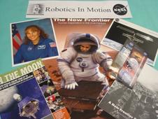 Educational resources related to robotics are grouped on a table