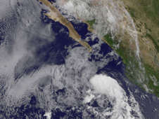 GOES-11 shows the Guatemalan low as a comma-shaped area of clouds off of the west Central American coast.