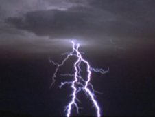 Video still image, lightning in darkened sky