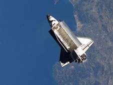 Image of STS-129 of Atlantis above the earth. The space shuttle orbiter gets electricity from fuel cells that reached TRL 9.