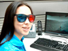 An intern dons 3D glasses to look at some Mars images in her cubicle at JPL